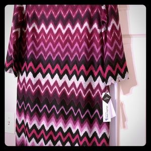 Fall is here! This dress will go great with boots.